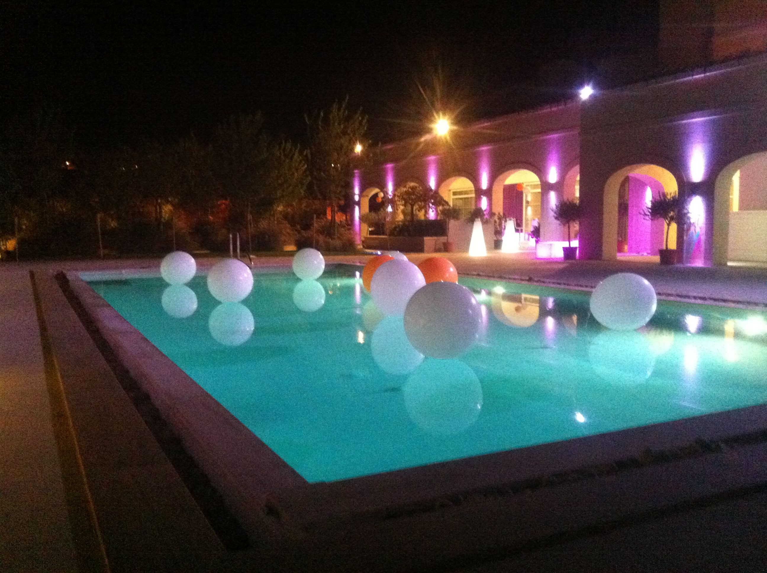 All White Pool Party Ideas  White and touch of orange balloons pool decoration
