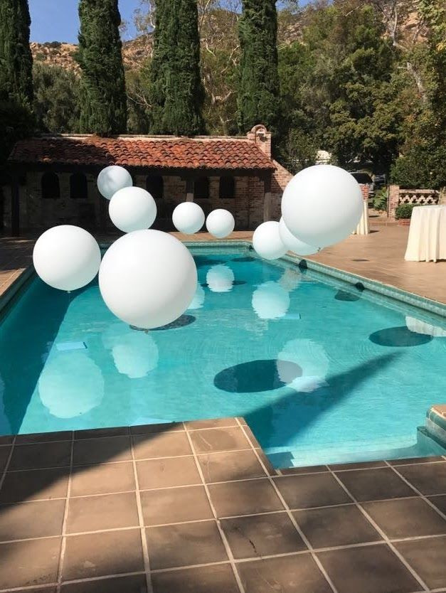 All White Pool Party Ideas  Jumbo balloons over this pool create a magical look for
