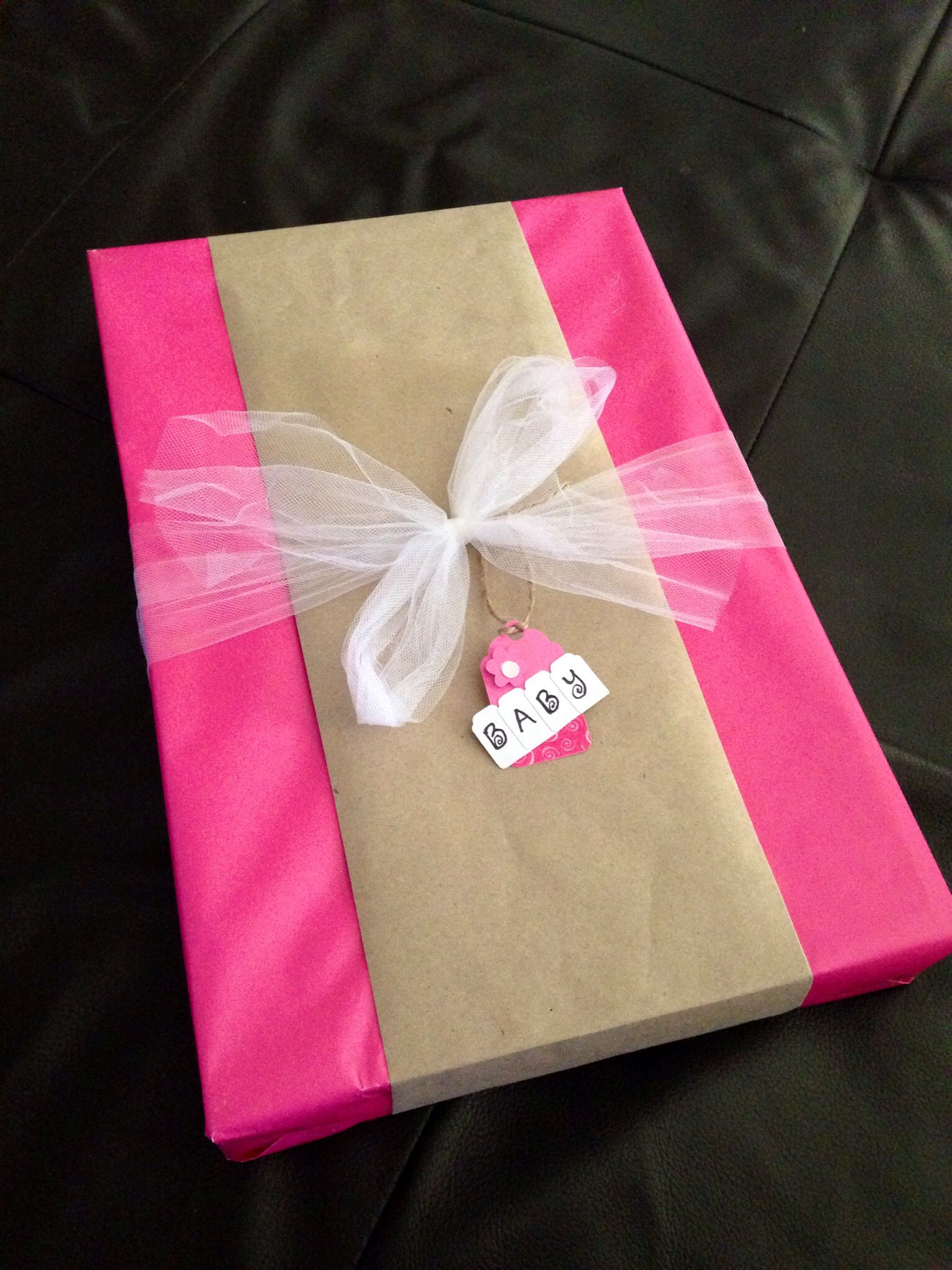 Baby Shower Gift Wrapping Ideas  DIY baby shower t wrap idea Solid pink wrapping paper