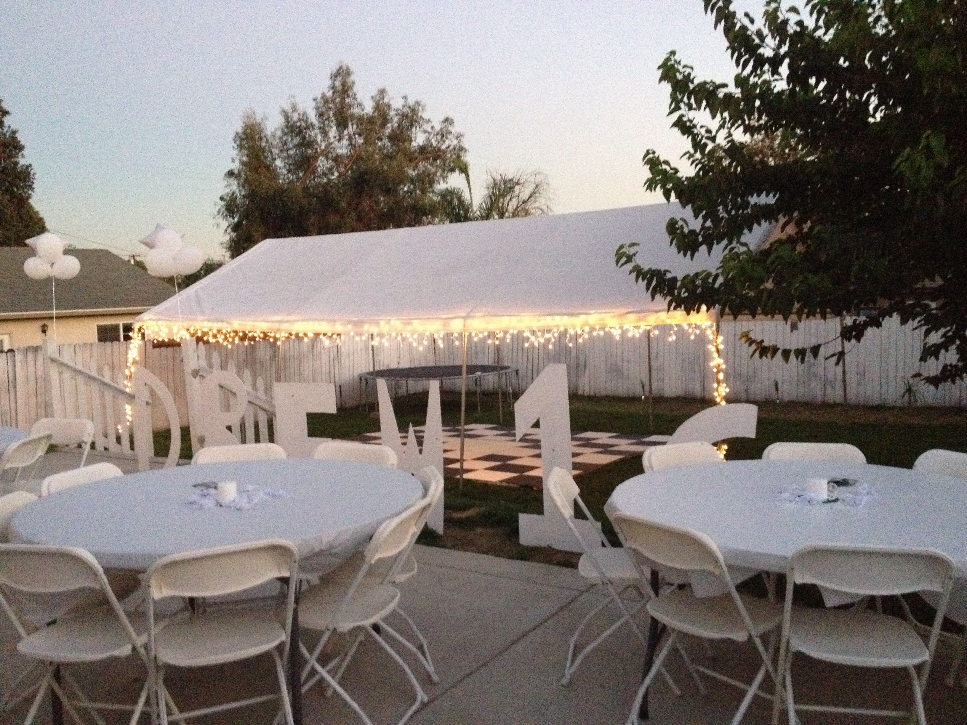Backyard Sweet Sixteen Party Ideas  All white party backyard set up