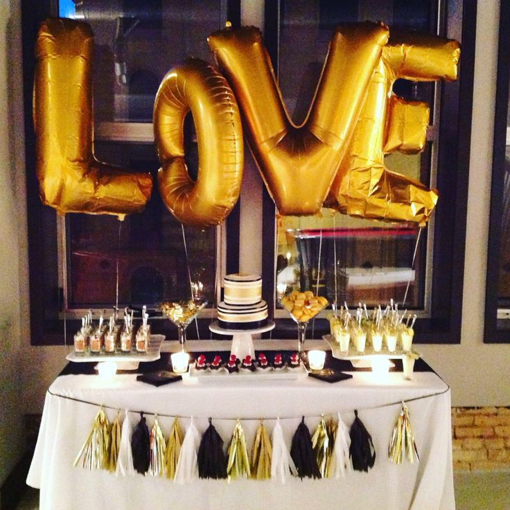 Black And Gold Engagement Party Ideas  Drunk on love stock the bar party dessert table Black