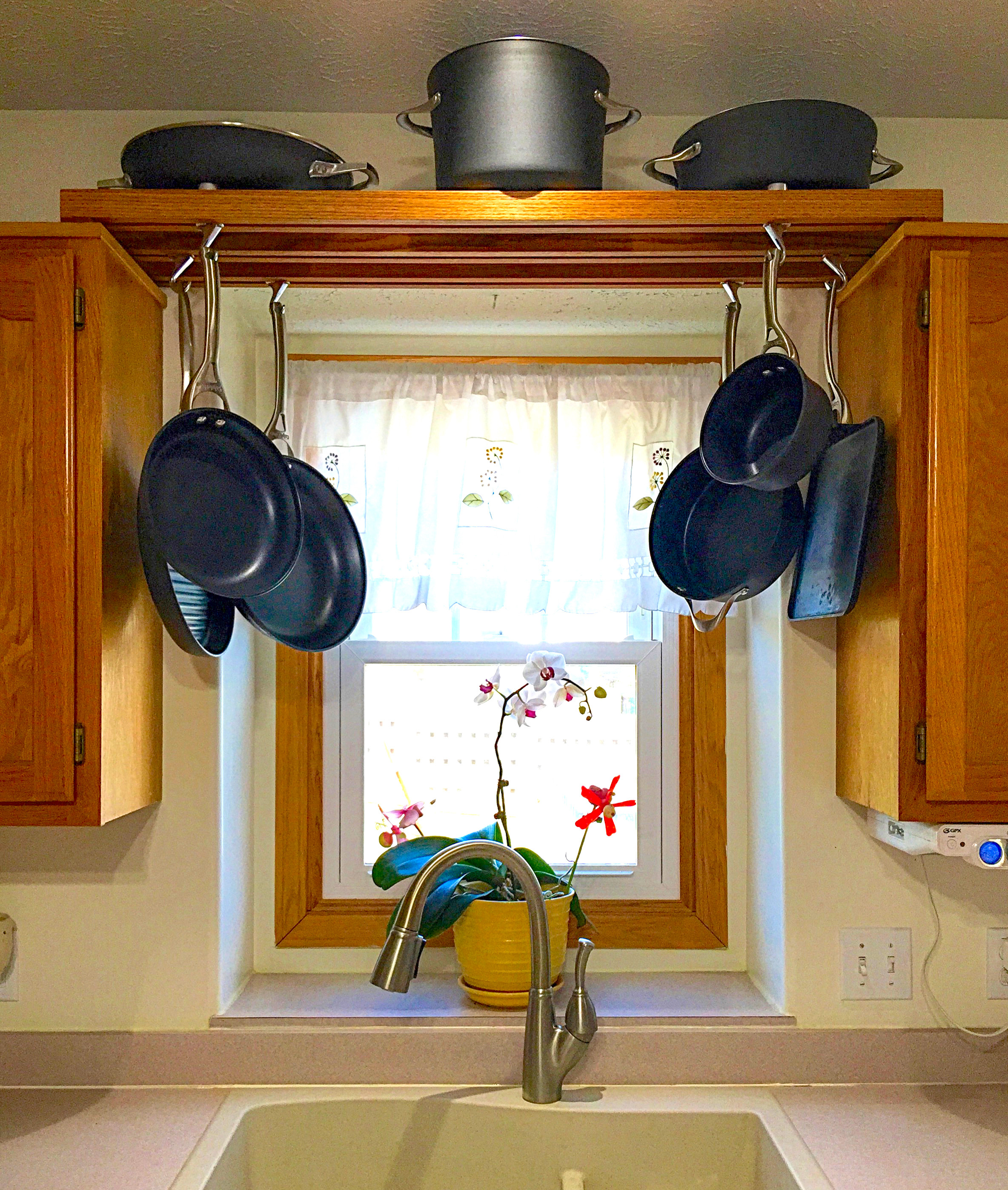 DIY Pots And Pans Rack  Make use of space over the kitchen sink with this DIY pot