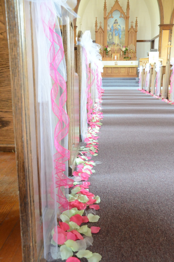 DIY Wedding Pew Decorations  pew bows and petals along the aisle