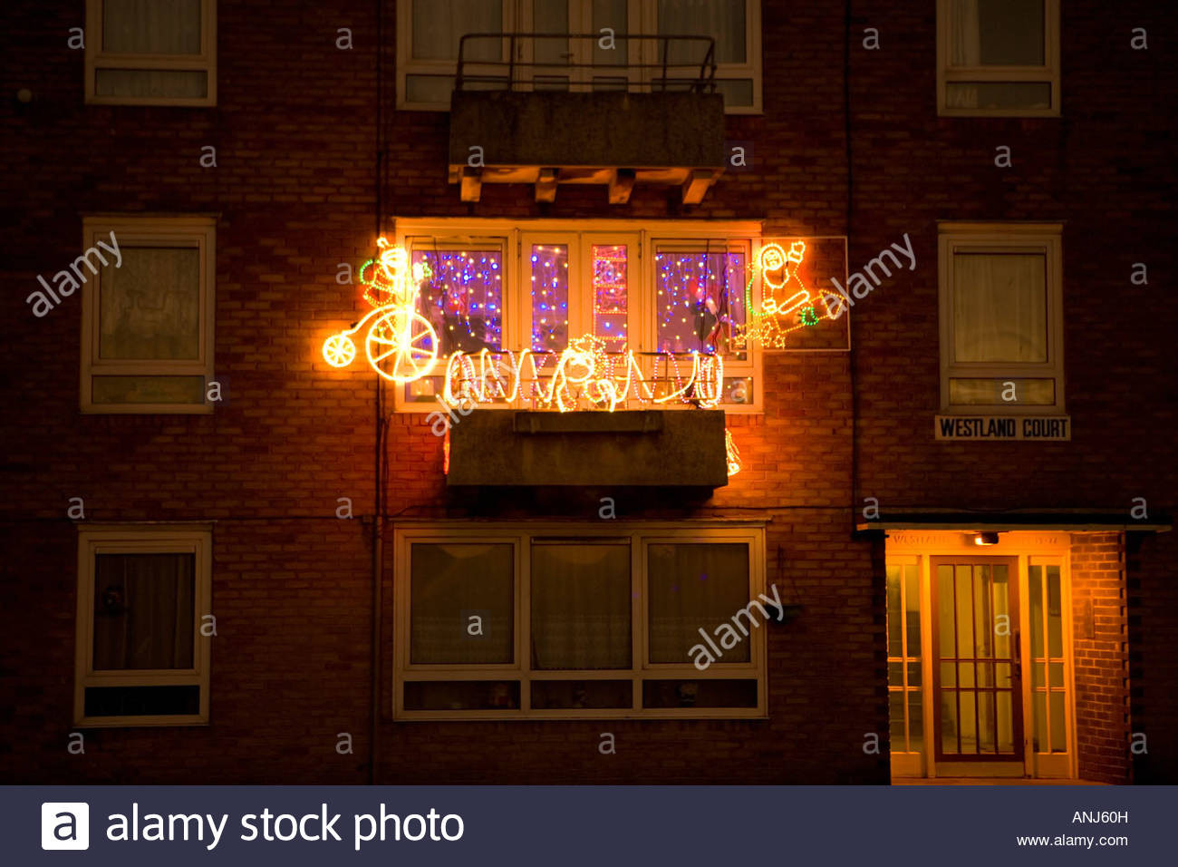 Apartment Balcony Christmas Lights  Christmas lights at night decorating a balcony in a block