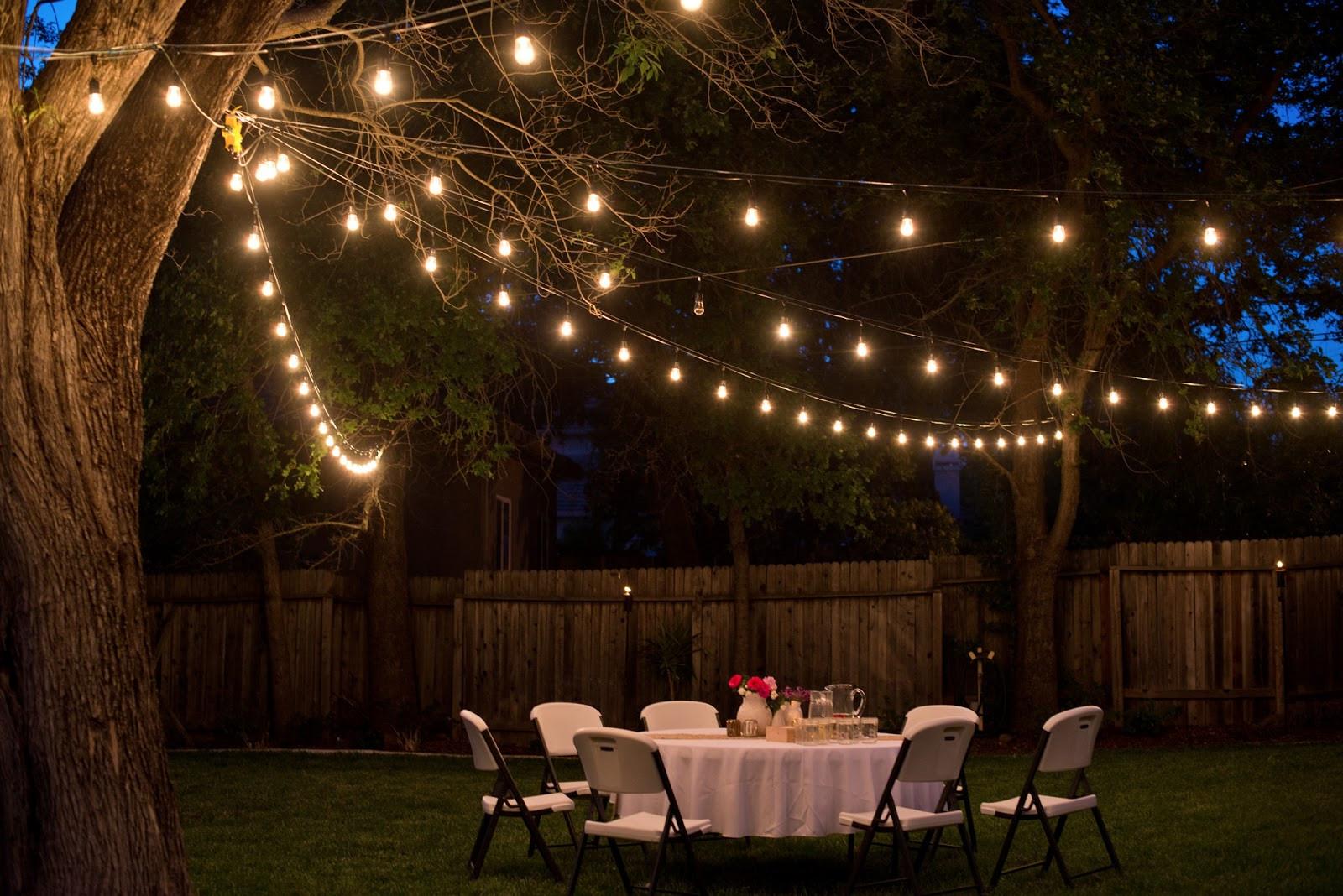 Backyard Party Ideas Lighting  Domestic Fashionista Backyard Anniversary Dinner Party