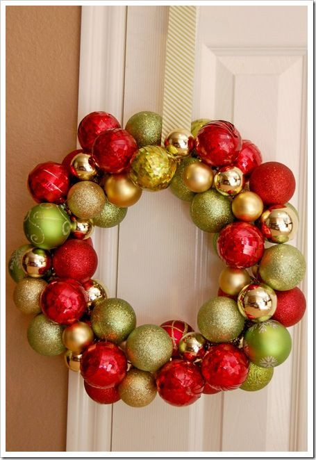 Christmas Ball Wreath DIY  Wreath made from dollar store ornaments and a wire coat
