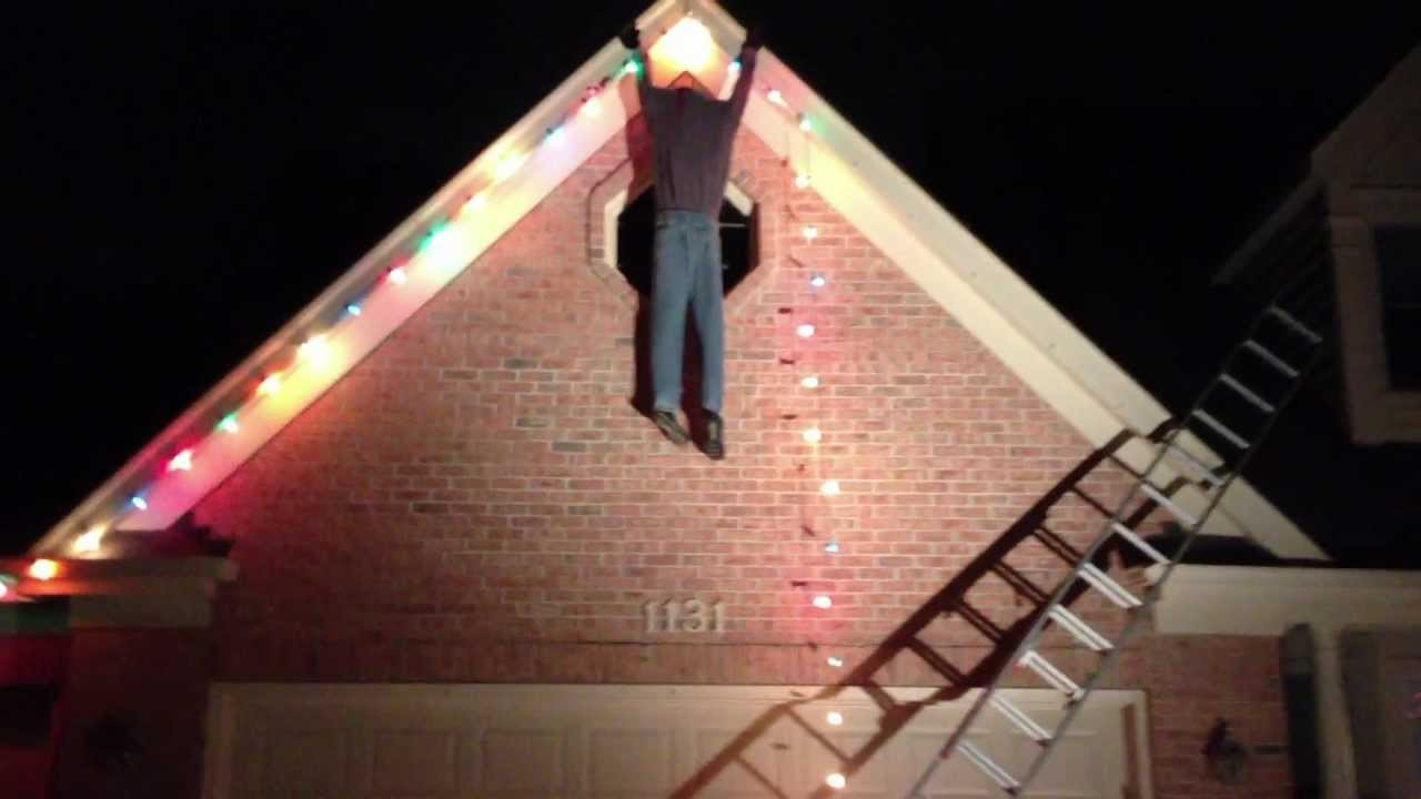 Christmas Rooftop Decorating Ideas  Guy Falling off Ladder Fail Christmas Decoration