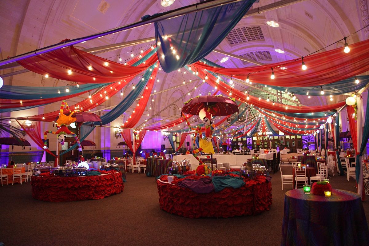 Corporate Halloween Party Ideas  Lights and sheer draping create an elegant indoor carnival