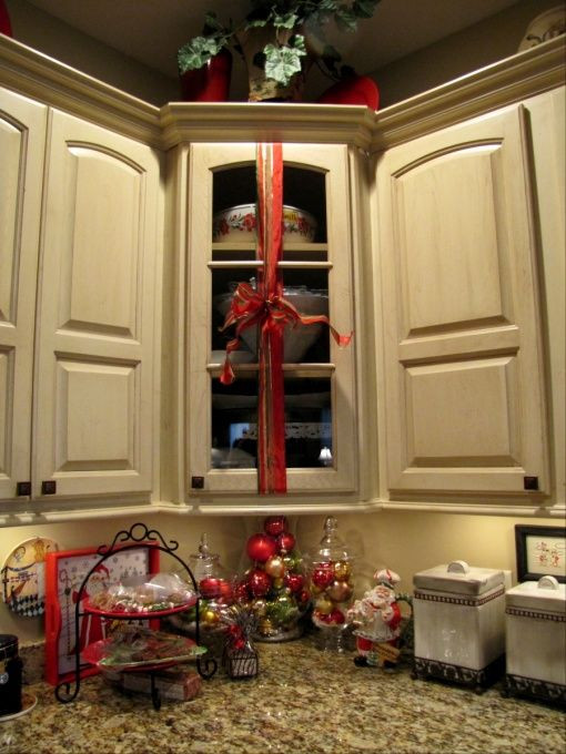 Kitchen Cabinet Christmas Decorating Ideas  Wrap ribbon with a bow around kitchen cabinets What a