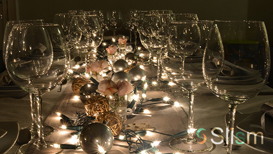 Unique Christmas Party Ideas  Elegant dining table with ornaments and elegant glasses