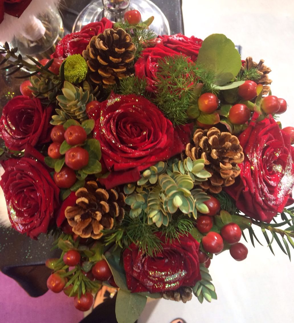 Christmas Flower Bouquets  Christmas wedding flowers in a brides hand tied bouquet of