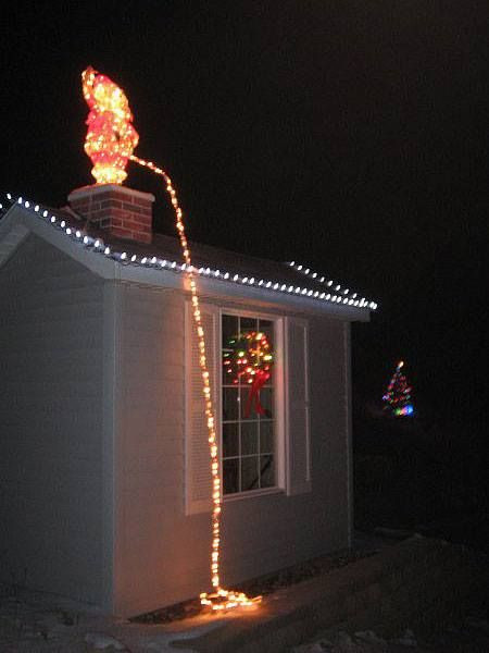 Christmas Rooftop Decorations  Rooftop Decor Santa peeing off roof