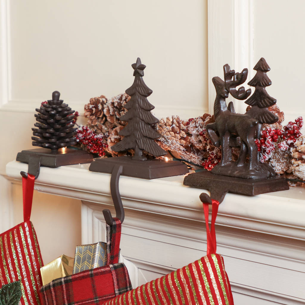 Christmas Stocking Hangers For Fireplace  walk in the woods cast iron christmas stocking holders by