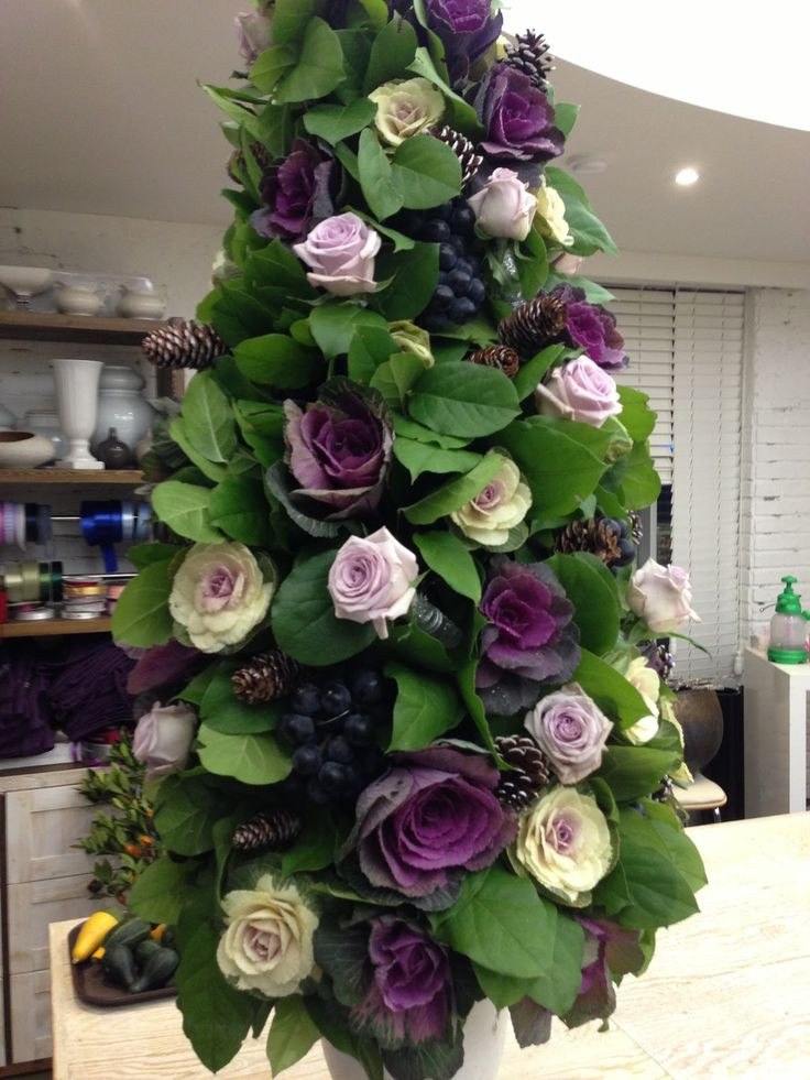 Christmas Tree Flower Arrangement  Using Kale and purple roses in a unique topiary via Paula